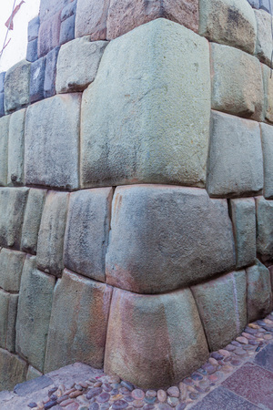 roca: Detail of Incas perfect stonework. Wall of former palace of Inca Roca in Cuzco, Peru. Stock Photo