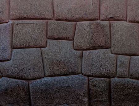 stonework: Detail of Incas perfect stonework. Wall of former palace of Inca Roca in Cuzco, Peru. Stock Photo