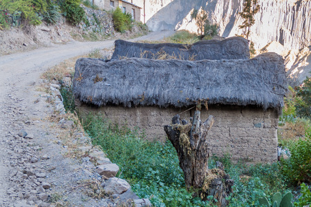 adobe wall: Small houses in village Cosnirhua in Colca canyon, Peru Editorial