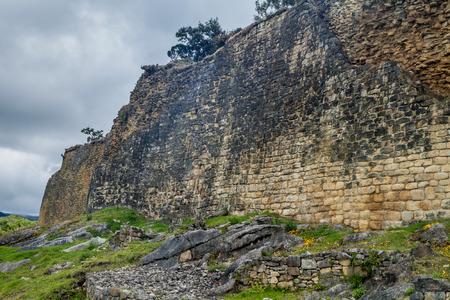 Stone wall of Kuelap, ruined citadel city of Chachapoyas cloud forest culture in mountains of northern Peru.