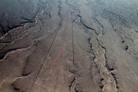 trapezoid: Aerial view of geoglyphs near Nazca - famous Nazca Lines, Peru. This figure is called Trapezoid.