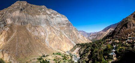 Panorama of Colca canyon, Peru. San Juan de Chuccho village on the right side.