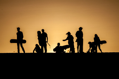 desert oasis: Silhouettes of sand boarders during the sunset near desert oasis Huacachina near Ica, Peru