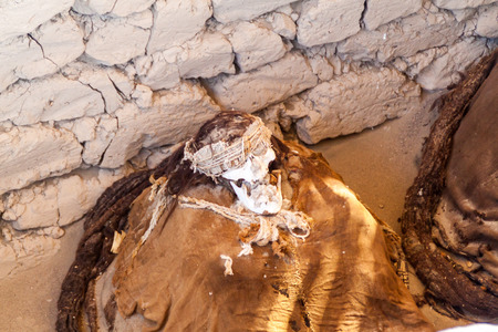 mummified: Preserved mummy in a tomb of Chauchilla cemetery in Nazca, Peru Editorial