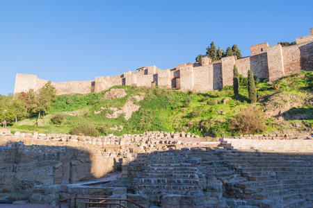 Roman amphitheater and Alcazaba fortress ruins in Malaga, Spain