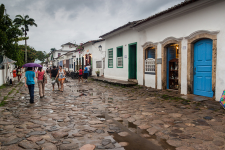 PARATY, BRAZIL - JANUARY 30, 2015: People walk in a narrow street an old colonial town Paraty, Brazil