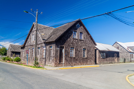 excitation: View of wooden houses lining streets of Curaco de Velez village, Quinchao island, Chile