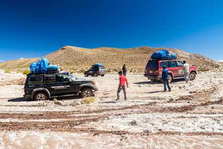 SOUTHWESTERN BOLIVIA - APRIL 14, 2015: One of 4WD vehicle carriing  tourists stuck at the popular Salar de Uyuni tour.