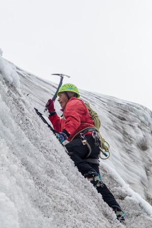 crampon: HUAYNA POTOSI, BOLIVIA - APRIL 25, 2015: Local mountain guide climbing the glacier at Huayna Potosi mountain, Bolivia