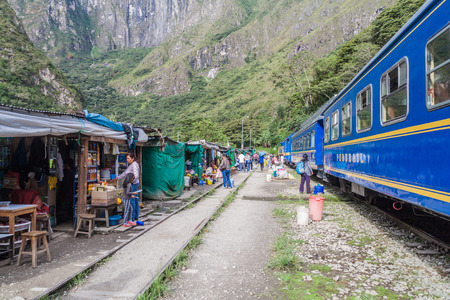 HIDROELECTRICA, PERU - MAY 17, 2015: Peru Rail train stops at the station Hidroelectrica in Urubamba river valley. Train head towards Aguas Calientes near Machu Picchu ruins.