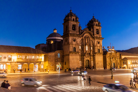 CUZCO, PERU - MAY 23, 2015:  La Compania de Jesus church on Plaza de Armas square in Cuzco, Peru.