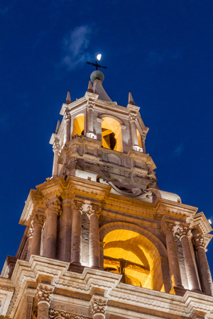Tower of a cathedral and the moon at Plaza de Armas square in Arequipa, Peru. Stock Photo
