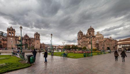 la compania: CUZCO, PERU - MAY 23, 2015:  Cathedral and La Compania de Jesus church on Plaza de Armas square in Cuzco, Peru. Stock Photo