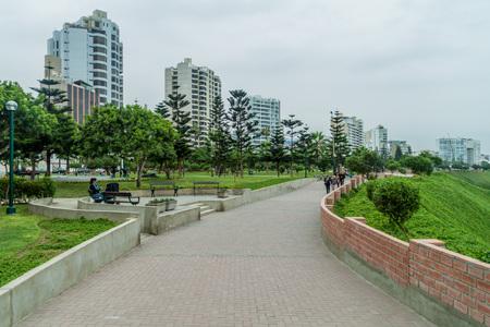 LIMA, PERU - JUNE 4, 2015: People enjoy a park in Miraflores district of Lima, Peru.