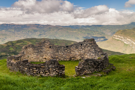 Remnants of a round house in Kuelap, ruined citadel city of Chachapoyas cloud forest culture in mountains of northern Peru. Stock Photo