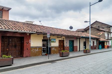 cuenca: CUENCA, ECUADOR - JUNE 19, 2015: Street with old colonial buildings in the center of Cuenca, Ecuador
