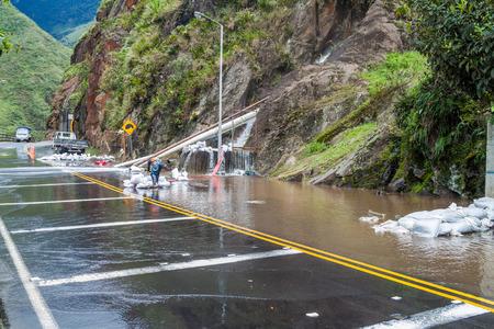 BANOS, ECUADOR - JUNE 22, 2015: Workers are repairing leaking tubes from Agoyan Hydroelectric plant, Ecuador