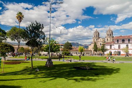 plaza of arms: CAJAMARCA, PERU - JUNE 8, 2015: Plaza de Armas square with a cathedral in Cajamarca, Peru.