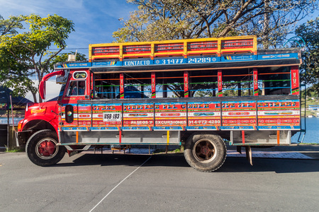 GUATAPE, COLOMBIA  - SEPTEMBER 2, 2015: Colorful chiva buses are important part of rural public transport in Colombia.