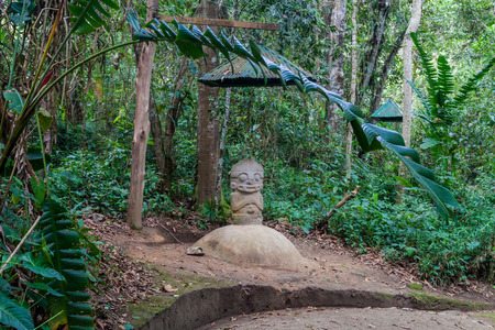 Ancient statue in archeological park in San Agustin, Colombia