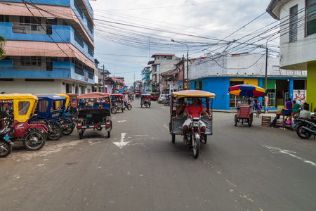 mototaxi: IQUITOS, PERU - JUNE 17, 2015: View of a street full of mototaxis in Iquitos, Peru