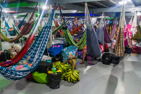 plies: AMAZON, BRAZIL - JUNE 22, 2015: Passengers of hammock deck at the boat Diamante which plies river Amazon between Tabatinga and Manaus, Brazil. Editorial
