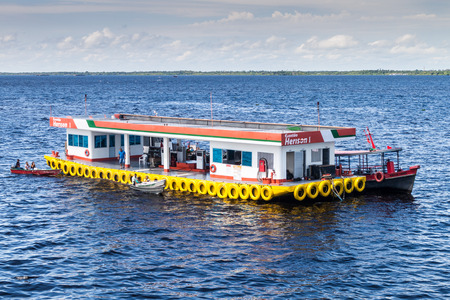 MANAUS, BRAZIL - JULY 27, 2015: Floating gas station  at Manaus port, Brazil