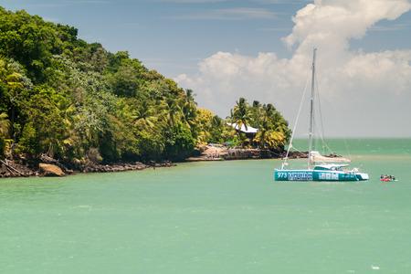ILE SAINT JOSEPH, FRENCH GUIANA - AUGUST 2, 2015: Catamaran anchored by Ile Saint Joseph, one of the islands of Iles du Salut (Islands of Salvation) in French Guiana.