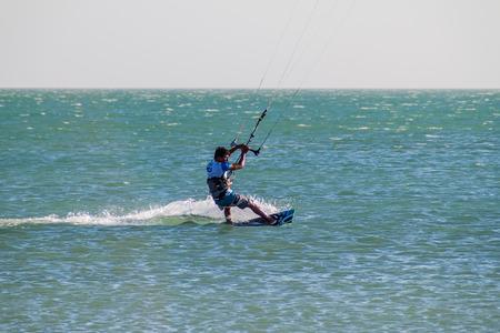 kiteboarding: CABO DE LA VELA, COLOMBIA - AUGUST 23, 2015: Kitesurfer in a sea near village Cabo de la Vela located on La Guajira peninsula.