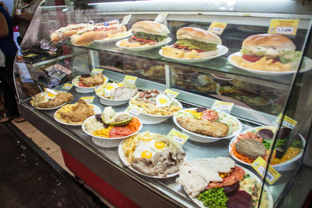 SANTIAGO, CHILE - FEB 28, 2015: Meals on display in a eatery in city center in Santiago de Chile Editorial