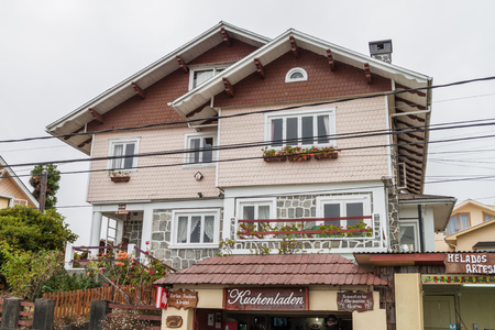 FRUTILLAR, CHILE - MARCH 1, 2015: House with a store selling Kuchen (German cake) in Frutillar village. The region is known for a strong population of german immigrants. Sajtókép