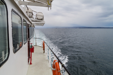 PUNTA ARENAS, CHILE - MARCH 4, 2015: Ferry Melinka heading to Penguin colony on Isla Magdalena island in Magellan Strait, Chile