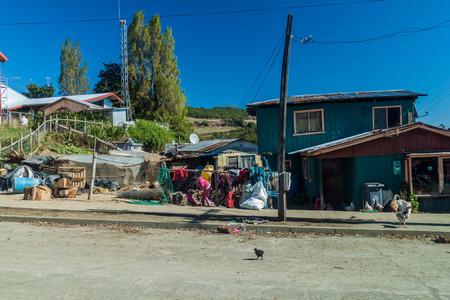 CURACO DE VELEZ, CHILE - MARCH 21, 2015: Poor houses of fishermen in Curaco de Velez village, Quinchao island, Chile Editorial