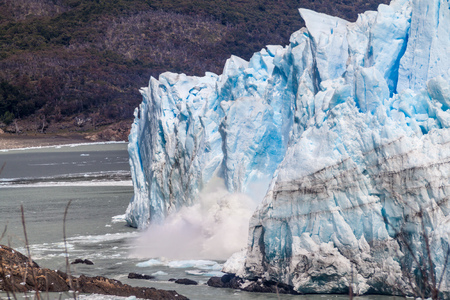 Ice falling from Perito Moreno glacier, Argentina Stock Photo