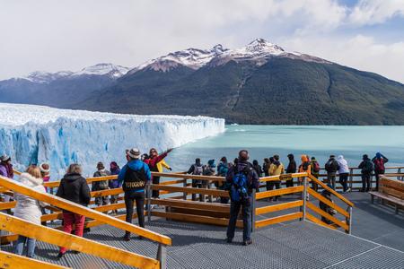 calafate: PERITO MORENO, ARGENTINA - MARCH 10, 2015: Tourists on boardwalks around Perito Moreno glacier, Patagonia, Argentina