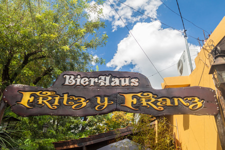 VILLA GENERAL BELGRANO, ARGENTINA - APR 3, 2015: Sign of a beer pub in Villa General Belgrano, Argentina. Village now serves as a Germany styled tourist attraction. Editorial