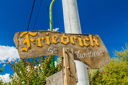 VILLA GENERAL BELGRANO, ARGENTINA - APR 3, 2015: Sign of a tourist shop in Villa General Belgrano, Argentina. Village now serves as a Germany styled tourist attraction. Editorial