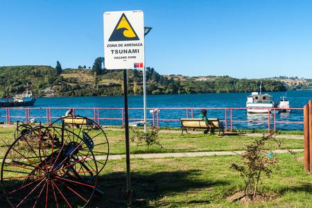 CASTRO, CHILE - MARCH 22, 2015: Tsunami hazard warning sign in Castro, Chiloe island, Chile