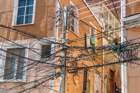 power cables: Mess of wires in Valparaiso, Chile Stock Photo