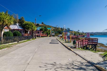 CURACO DE VELEZ, CHILE - MARCH 21, 2015: Seaside road in Curaco de Velez village, Quinchao island, Chile