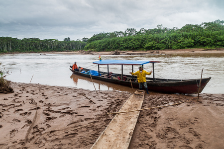 MADIDI, BOLIVIA - MAY 7, 2105: Tour guides in a canoe on Beni river in Madidi National Park, Bolivia