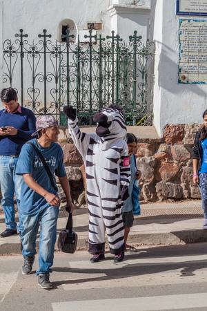 traffic warden: SUCRE, BOLIVIA - APRIL 22, 2015: Zebra traffic warden is helping with the traffic in Sucre, capital of Bolivia
