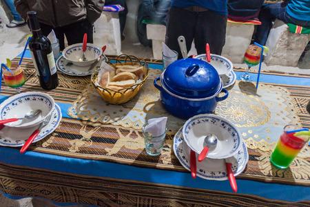 PUERTO CHUVICA, BOLIVIA - APRIL 16, 2015: Dinner meade for tourists in a hotel made of salt near salt plain Salar de Uyuni, Bolivia. Stock Photo