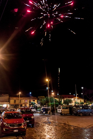 OLLANTAYTAMBO, PERU - MAY 19, 2015: Fireworks on Plaza de Armas square in Ollantaytambo, Sacred Valley of Incas, Peru