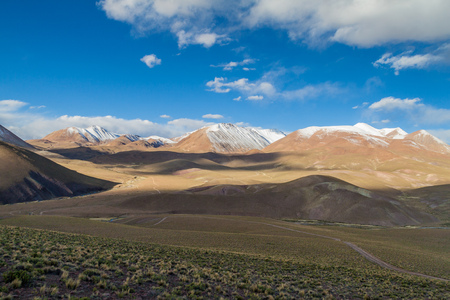 avaroa: Snow covered mountains soaring from altiplano in Bolivia