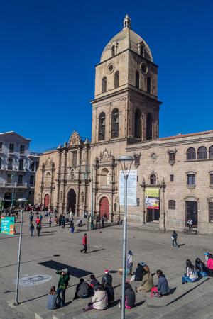 LA PAZ, BOLIVIA - MAY 11, 2015: People walk in front of San Francisco church in the center of La Paz, Bolivia.