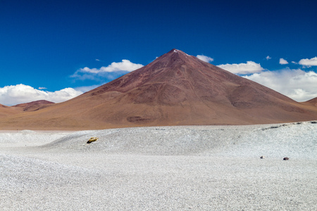 Borax deposits at Laguna Colorada lake with mountain peaks in the background, Bolivia Stock Photo