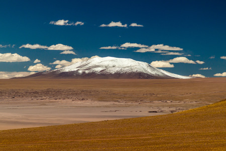 Snow covered peak at bolivian Altiplano