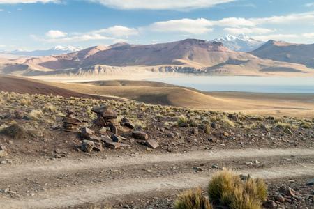 avaroa: Lago Morejon lake with Volcano Uturuncu in the background at the altiplano in Bolivia Stock Photo