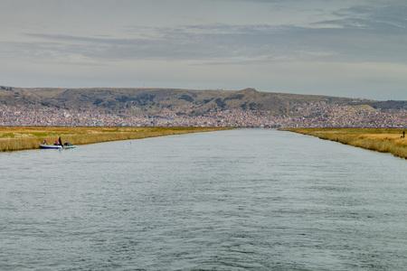 navigable: Waterway in the reeds of Titicaca lake, Peru Stock Photo